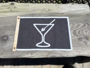 A photo of a canvas flag with a martini glass design